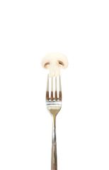 Slice of mushroom pinned on a fork