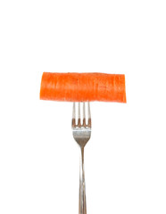 Large piece of carrot pinned on a fork