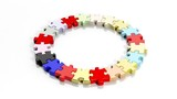 Colorful jigsaw puzzle pieces in a circle isolated