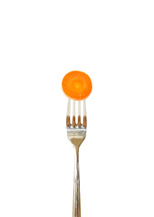Slice of carrot pinned on a fork