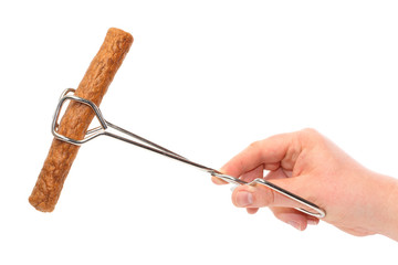 Dutch fast food snack frikandel in frying tongs