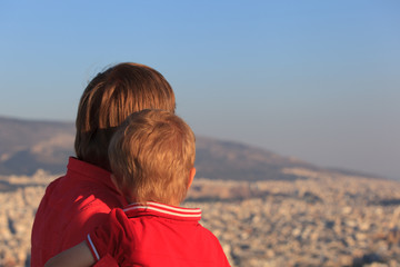 father and son looking at Athens, Greece