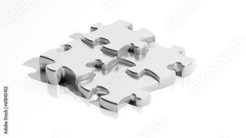 Silver jigsaw puzzle pieces isolated on white background © viperagp