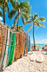 Surfboards in the rack at Waikiki Beach