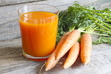 Carrot juice organic on wooden boards