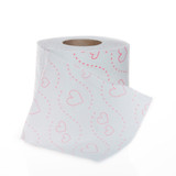 Single roll of toilet paper with hearts pattern