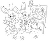 Easter Bunnies drawing a decorated Easter egg