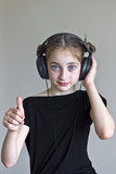 young girl is listening musiс