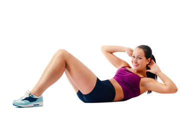 beautiful woman in sportswear does exercises lying on floor