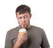 Funny man drinking from a disposable paper cup on white