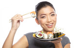 Sushi woman holding sushi with chopsticks