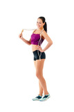 young woman with jump rope on shoulder stand sideways in sportsw