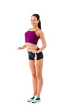 young woman with  jump rope round  waist stand sideways in sport