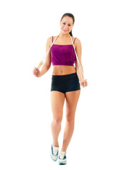 young woman with jump rope on shoulder  in sportswear