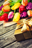 Multicolor tulips bouquet and gift box