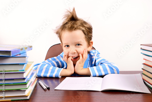 cute boy laughing sitting at the desk