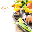Easter table setting with yellow tulips