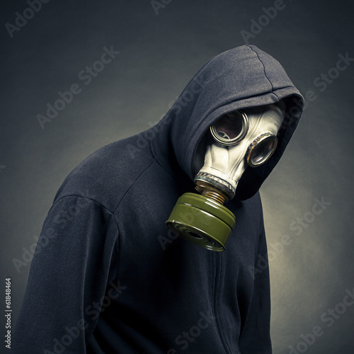 A man in a gas mask on a dark background