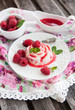 Delicious dessert with raspberry sauce and fresh berries