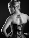 Blond woman wearing leather corset