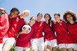 Female soccer team against clear blue sky