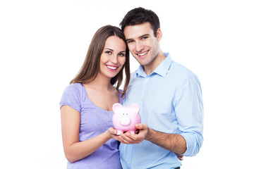 Couple holding piggy bank