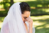 Close-up of beautiful worried bride at park