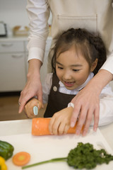 girl cutting carrots