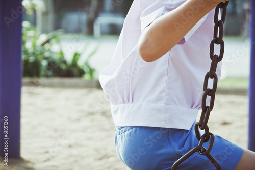 Little child on a swing in the park