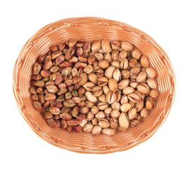 Wicker basket with pistachios.
