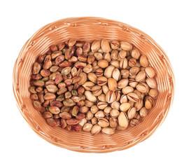 Wicker basket with pistachios.