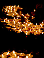lit candles in a church during the funeral celebration