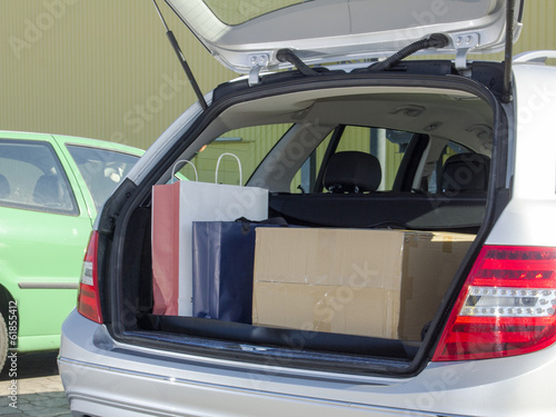Open loaded trunk of car