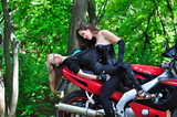 Two passionate girl on sports bike