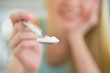 Closeup on young woman giving spoon with yogurt