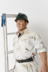 male worker with stepladder
