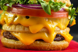 Lot of melting cheese in burger closeup