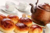 Home baked sweet buns with old copper pot