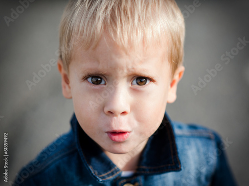Portrait of the offended little boy