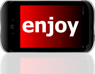 Web development concept: smartphone with word enjoy on display