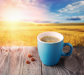 cup of morning coffee at sunrise