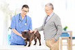 Senior gentleman taking his dog to a veterinary practice