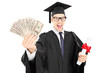 Young college graduate holding a diploma and money