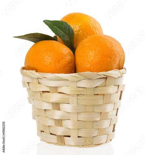 Mandarins in basket on a white background