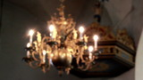 Elegant lighted chandelier hanging in church