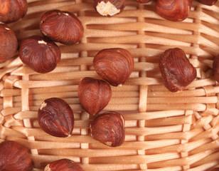Close up of hazel nuts on a wicker basket.