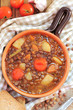 Rustic lentil soup with cherry tomatoes, potatoes and leek