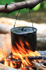 tourist kettle on fire