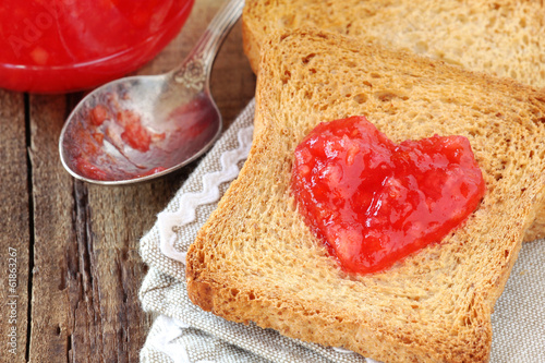 whole wheat toasts with red orange fruit marmalade