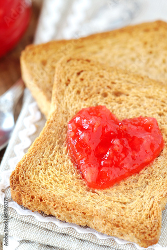 Whole wheat toasts with red orange fruit jam